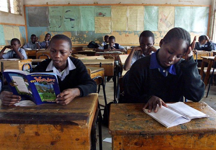 Kenyan children learn by their own in a classroom during a teacher strike.