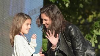 NEW YORK, NY - SEPTEMBER 26:  Suri Cruise (L) and actress Katie Holmes speak  on stage at the 2015 Global Citizen Festival to end extreme poverty by 2030 in Central Park on September 26, 2015 in New York City.  (Photo by Theo Wargo/Getty Images for Global Citizen)