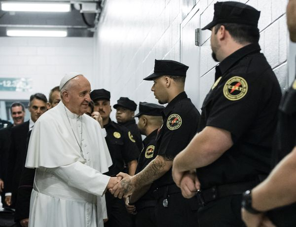 PHILADELPHIA, PA - SEPTEMBER 27: Pope Francis greets corrections officers during a visit to the Curran-Fromhold Correction Fa