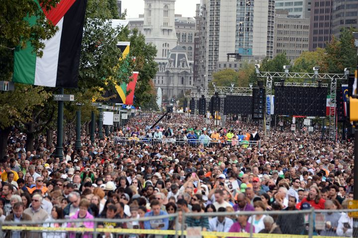 People listen as Pope Francis speaks during an open-air mass at the Benjamin Franklin Parkway in Philadelphia, Pennsylvania,