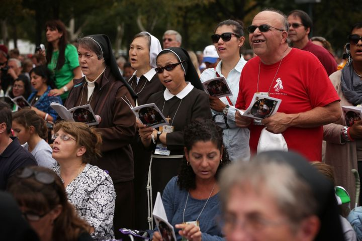 Members of the congregation sing during the Mass for the conclusion of the World Meeting of Families on Benjamin Franklin Par