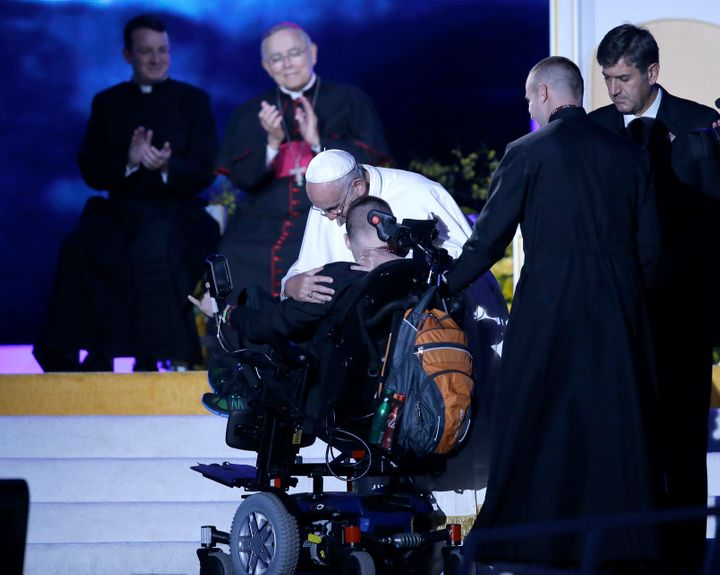 Pope Francis hugs a disabled member of a Ukrainian family during the Festival of Families on September 26, 2015 in Philadelph
