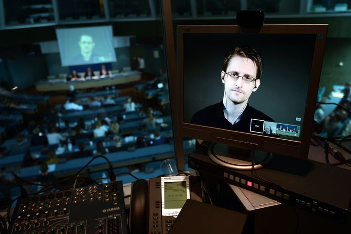 Snowden is seen via live video from Russia during a parliamentary hearing on the subject of 'Improving the protection of whis