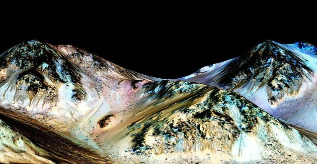 The dark streaks are known as recurring slope lineae and are believed to be evidence of flowing water....