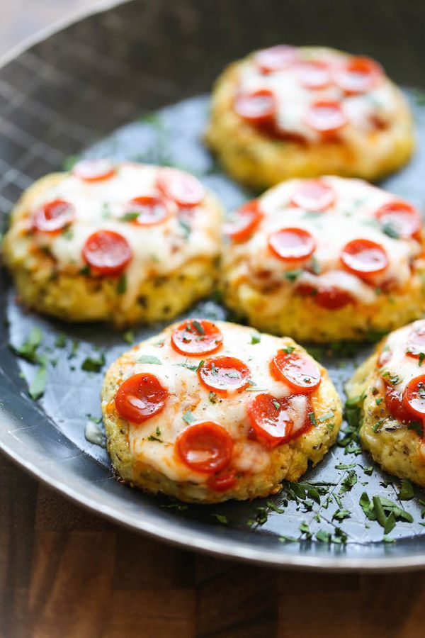 "<strong>Get the <a href=""http://damndelicious.net/2015/04/20/mini-cauliflower-pizzas/"" target=""_blank"">Mini Cauliflower Pizza"