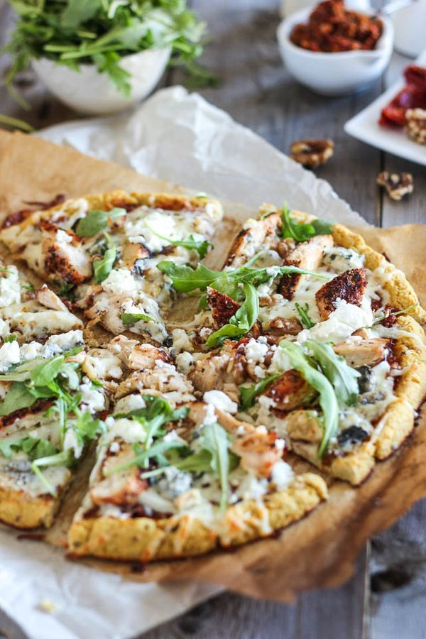 "<strong>Get the <a href=""http://thehealthyfoodie.com/cauliflower-crust-grilled-chicken-and-3-cheeses-pizza/"" target=""_blank"">"