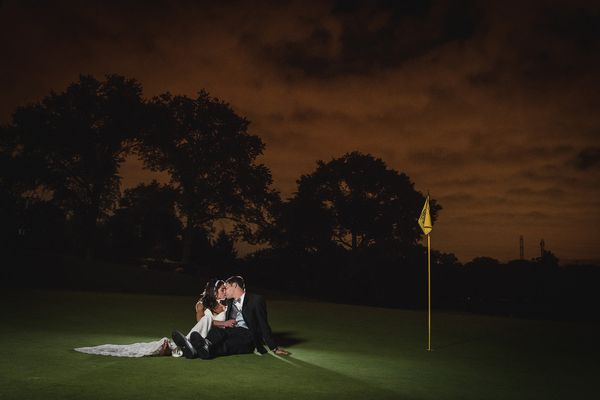 """""""The 18th green at Upper Montclair Country Club made for the perfect ending to Nick and Rebecca'€™s wedding."""" - Kevin Ferguso"""