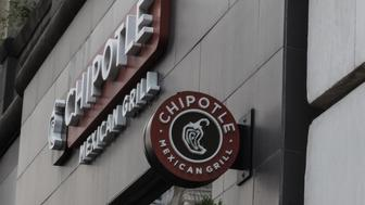 A Chipotle restaurant sign is seen in Manhattan on September 11, 2015 in New York. Chipotle's 1,850 restaurants spent September 9, 2015 in a cram effort to hire 4,000 new workers to staff a rapid expansion, as it adds 200 more outlets this year. Built on a pitch of fresh, organic and locally sourced ingredients for its burrito wraps and tacos, the thriving US chain is making clear it is not ready to ease up on expansion plans.  AFP PHOTO/KENA BETANCUR        (Photo credit should read KENA BETANCUR/AFP/Getty Images)