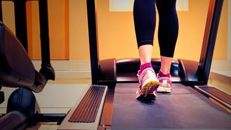 Girl running on treadmill in gym, close up. Canon 5D MK III