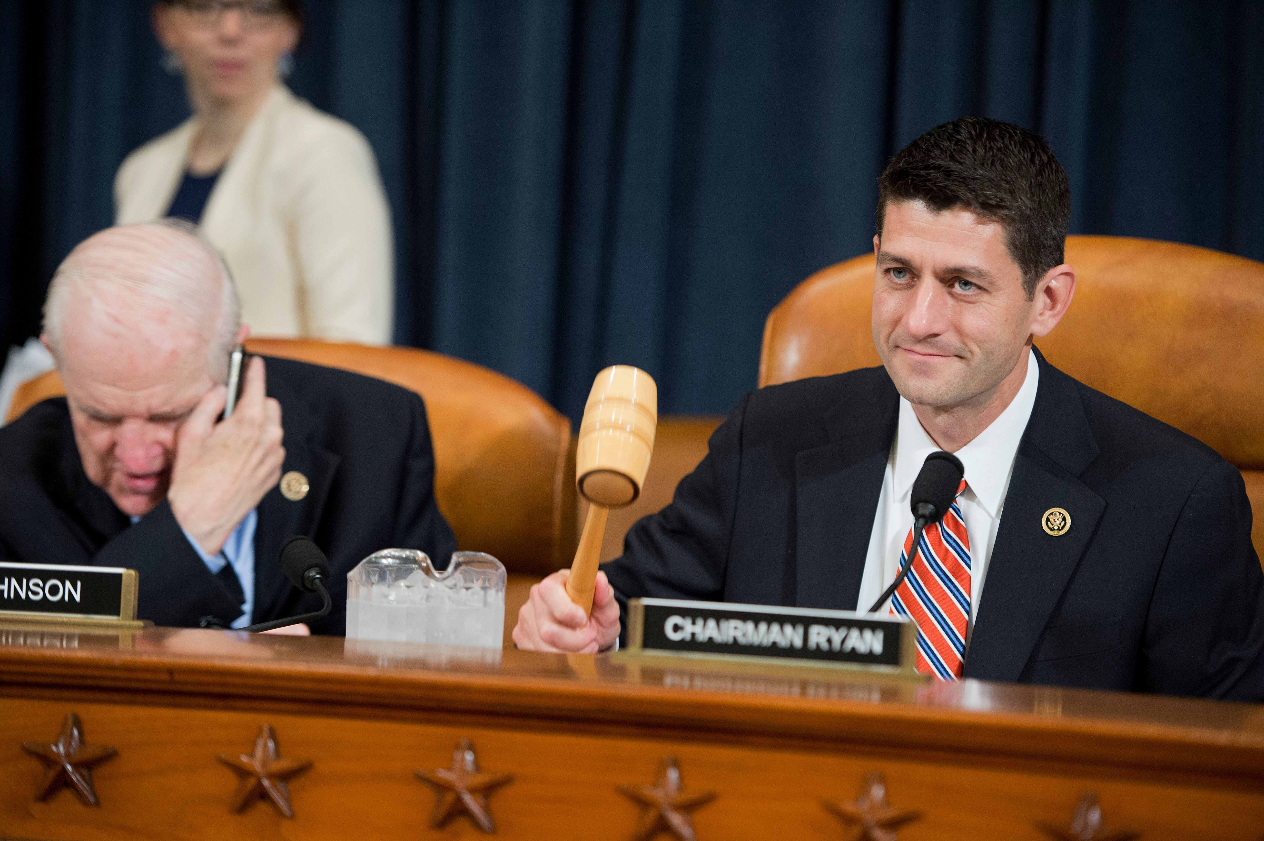 UNITED STATES - JUNE 10: Chairman Paul Ryan, R-Wisc., gavels in a House Ways and Means Committee hearing in Longworth Building titled 'Obamacare Implementation and the Department of Health and Human Services FY2016 Budget Request,' June 10, 2015. Rep. Sam Johnson, R-Texas, appears at left. HHS Secretary Sylvia Mathews Burwell, testified. (Photo By Tom Williams/CQ Roll Call)