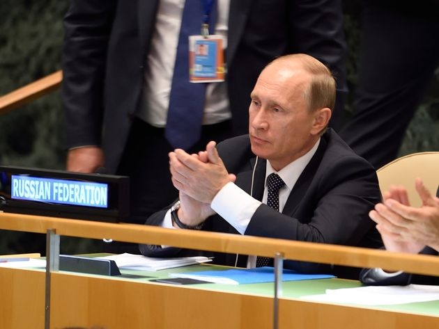 Russian President Vladimir Putin applauds during Xi's speech at the United Nations General