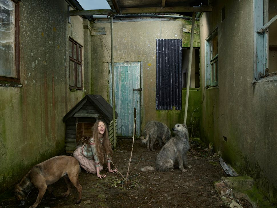 <strong>Oxana Malaya, Ukraine, 1991<br><br></strong>Oxana was found living with dogs in a kennel in 1991. She was 8 year