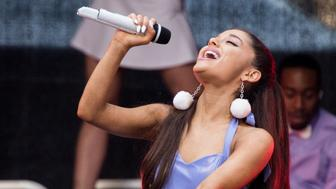 NEW YORK, NY - SEPTEMBER 16:  Singer Ariana Grande performs outside of Macys Herald Square at an 'ARI By Ariana Grande' fragrance launch event on September 16, 2015 in New York City.  (Photo by Noam Galai/WireImage)