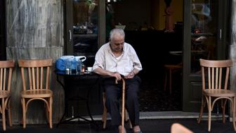 An old man sits in a coffee shop in central Athens on July 13, 2015. Greece reached a desperately-needed bailout deal with the eurozone on July 13 after marathon overnight talks, in a historic agreement to prevent the country crashing out of the European single currency. The country's leftist Prime Minister Alexis Tsipras agreed to tough reforms after 17 hours of gruelling negotiations in return for a three-year bailout worth up to 86 billion euros ($96 billion), Greece's third rescue programme in five years. AFP PHOTO / ARIS MESSINIS        (Photo credit should read ARIS MESSINIS/AFP/Getty Images)