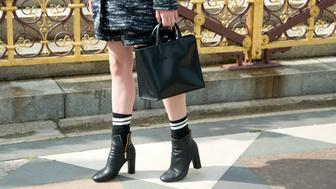 LONDON, ENGLAND - SEPTEMBER 15: Fashion Blogger Noor Degroot is wearing Topshop boots, jacket and skirt, Zara bag on day 4 of London Collections: Women on September 15, 2014 in London, England.  (Photo by Kirstin Sinclair/Getty Images)