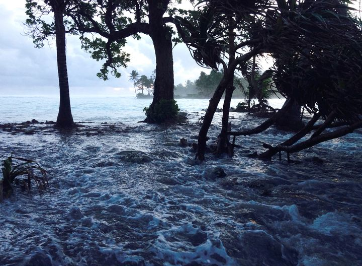 A high tide energized by storm surges washes across Ejit Island in Majuro Atoll, Marshall Islands, causing widespread floodin