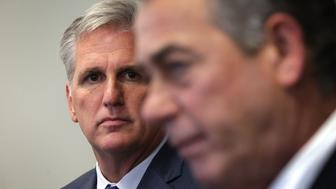 WASHINGTON, DC - SEPTEMBER 29:  U.S House Majority Leader Rep. Kevin McCarthy (R-CA) (L) listens as Speaker of the House Rep. John Boehner (R-OH) (R) speaks to member of the media after a House Republican Conference meeting September 29, 2015 at the U.S. Capitol in Washington, DC. House Republicans met to discuss GOP agenda including the government funding bill.  (Photo by Alex Wong/Getty Images)