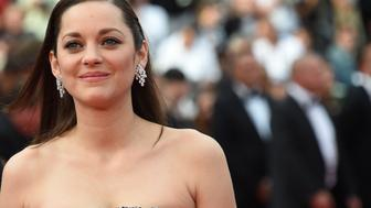 French actress Marion Cotillard poses as she arrives for the screening of the film 'Macbeth' at the 68th Cannes Film Festival in Cannes, southeastern France, on May 23, 2015.       AFP PHOTO / ANNE-CHRISTINE POUJOULAT        (Photo credit should read ANNE-CHRISTINE POUJOULAT/AFP/Getty Images)
