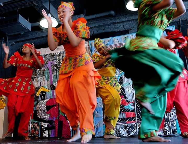 Members of the Restoration Dance Company perform a traditional African dance during a Kwanzaa festival at the Museum of Natur