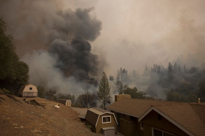 Smoke rises near a house on Mountain Ranch Road at the Butte Fire near San Andreas, California, on Sept. 13, 2015.
