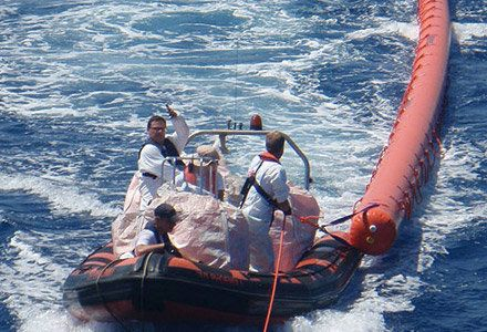 Rescue operators tow a CentiFloat in Aug. 2015. The tube-shaped, inflatable rubber floatis being dispatched to agencies