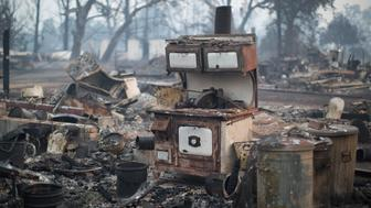 MIDDLETOWN, CA - SEPTEMBER 15:  A wood burning stove stands in the ruins of a home that burned in the Valley Fire are seen on September 15, 2015 in Middletown, California. The 104-square-mile fire is only 15 percent contained and has destroyed 585 homes so far and hundreds of other structures.  (Photo by David McNew/Getty Images)