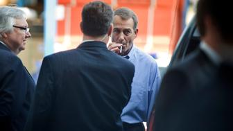 UNITED STATES - SEPTEMBER 23:  House Minority Leader John Boehner, R-Ohio, smokes a cigarette after a news conference outside of Tart Lumber Company in Sterling, Va., were they unveiled 'A Pledge to America,' a governing agenda devised by House Republicans for the 111th Congress.  (Photo By Tom Williams/Roll Call via Getty Images)