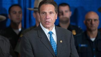 MALONE, NY - JUNE 28: Surrounded by police officers,  New York Gov. Andrew Cuomo speaks to the media about the capture of convicted murderer David Sweat on June 28, 2015 in Malone, New York. Sweat was shot by a State Police officer and taken into custody in Constable, New York, north of Malone and near the Canadian border. On Friday Richard Matt, who escaped with Sweat, was shot and killed in the same area. More than 1,000 State Police, Border Patrol, correction officers, FBI and other law enforcement agencies have been searching for the pair since they were discovered missing from a prison in nearby Dannemora on June 6.