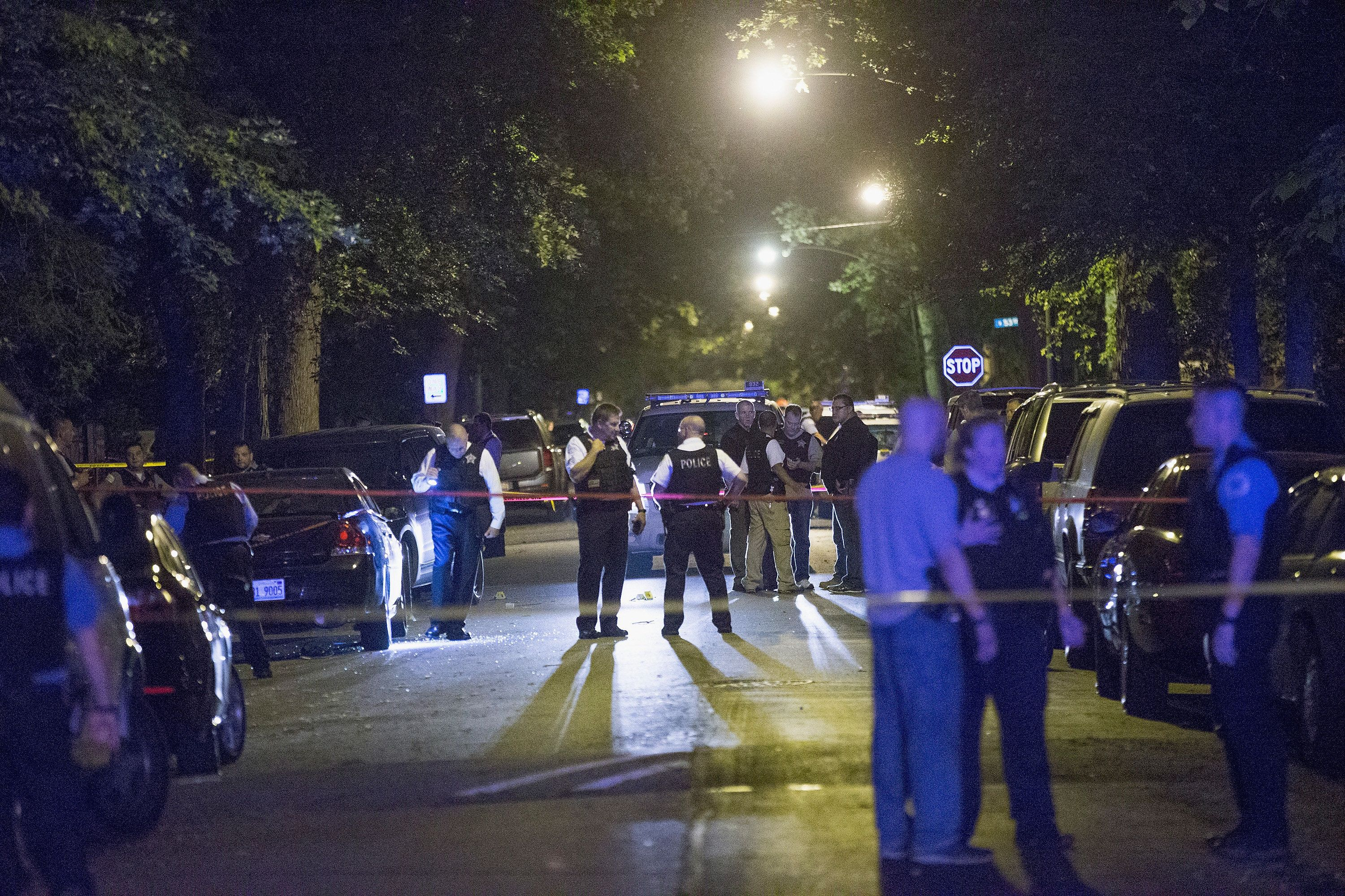 Chicago police investigate ashooting scene where five people, including an 11-month-old child, were killed or injured o