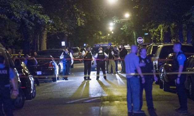 """<span class='image-component__caption' itemprop=""""caption"""">Chicago police investigate ashooting scene where five people, including an 11-month-old child, were killed or injured on Sept. 28, 2015.</span>"""