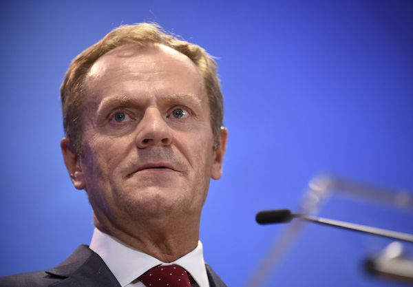 "The migrant and refugee crisis, Tusk said, demands global solidarity. <br><br>""Everyone can offer help to the refugees,"" he s"