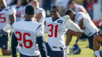 Houston Texans cornerback Charles James II (31) stretches during an NFL football training camp at the Methodist Training Center on Saturday August 1, 2015 in Houston, Texas. (AP Photo/Bob Levey)