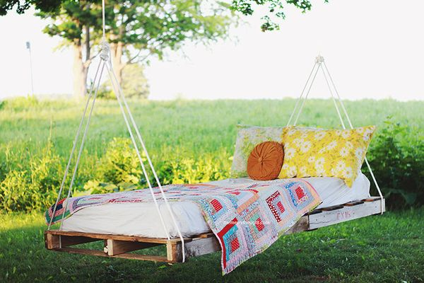 "Indoor or outdoor, this <a href=""http://themerrythought.com/diy/diy-pallet-swing-bed/"">hanging bed by The Merrythou"