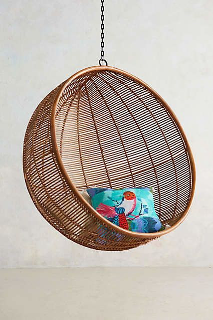 "Get the <a href=""http://www.anthropologie.com/anthro/product/32235160.jsp#/"">Rattan Hanging Chair</a> from Anthropo"