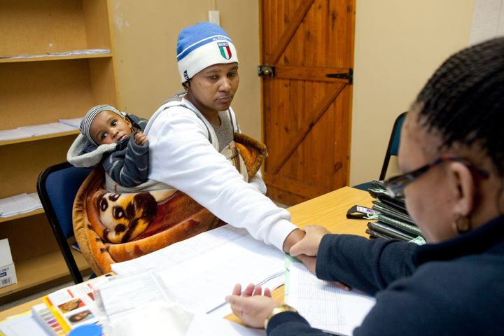 CAPE TOWN, SOUTH AFRICA - JUNE 3: A woman who was diagnosed with the HIV virus, but who is stable, has her heart rate checked