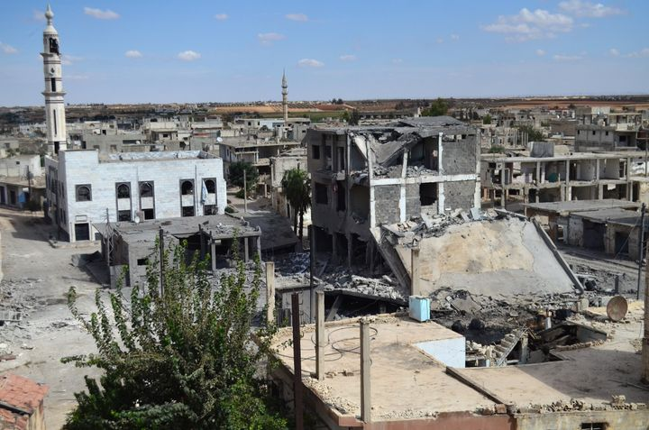 Buildings are damaged and streets are deserted in the town of Talbisseh in Homs province, Syria, on Sept. 30, 2015. On Wednes