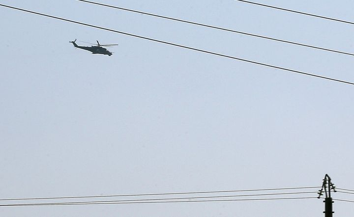 A Russian Mi-35attack helicopter hovers over Latakia airport in Syria on Sept. 24, 2015. Russia had already sent milita