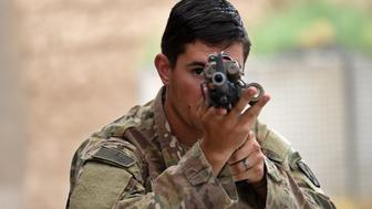 TO GO WITH AFGHANISTAN-US-ARMY-CONFLICT-FOCUS BY GUILLAUME DECAMME  In this photograph taken on August 12, 2015, a US army soldier takes aim during a military exercise at coalition force Forward Operating Base (FOB) Connelly in the Khogyani district in the eastern province of Nangarhar. From his watchtower in insurgency-wracked eastern Afghanistan, US army Specialist Josh Whitten doesn't have much to say about his Afghan colleagues. 'They don't come up here anymore, because they used to mess around with our stuff. 'Welcome to Forward Operating Base Connelly, where US troops are providing training and tactical advice to the 201st Afghan army corps as they take on the Taliban on the battlefield. AFP PHOTO / Wakil Kohsar        (Photo credit should read WAKIL KOHSAR/AFP/Getty Images)