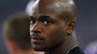 ARLINGTON, TX - AUGUST 29:  Adrian Peterson #28 of the Minnesota Vikings looks on from the sidelines as the Vikings take on the Dallas Cowboys in a preaseason game on August 29, 2015 in Arlington, Texas.  (Photo by Tom Pennington/Getty Images)
