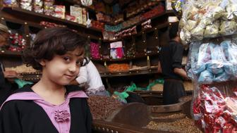 A Yemeni girl looks on at a market in the capital Sanaa on September 20, 2015, as Yemenis shop in preparation of the major Muslim festival of Eid al-Adha. Muslims across the world will celebrate the annual festival of Eid al-Adha, or the Festival of Sacrifice, which marks the end of the Hajj pilgrimage to Mecca and in commemoration of Prophet Abraham's readiness to sacrifice his son to show obedience to God. AFP PHOTO / MOHAMMED HUWAIS        (Photo credit should read MOHAMMED HUWAIS/AFP/Getty Images)