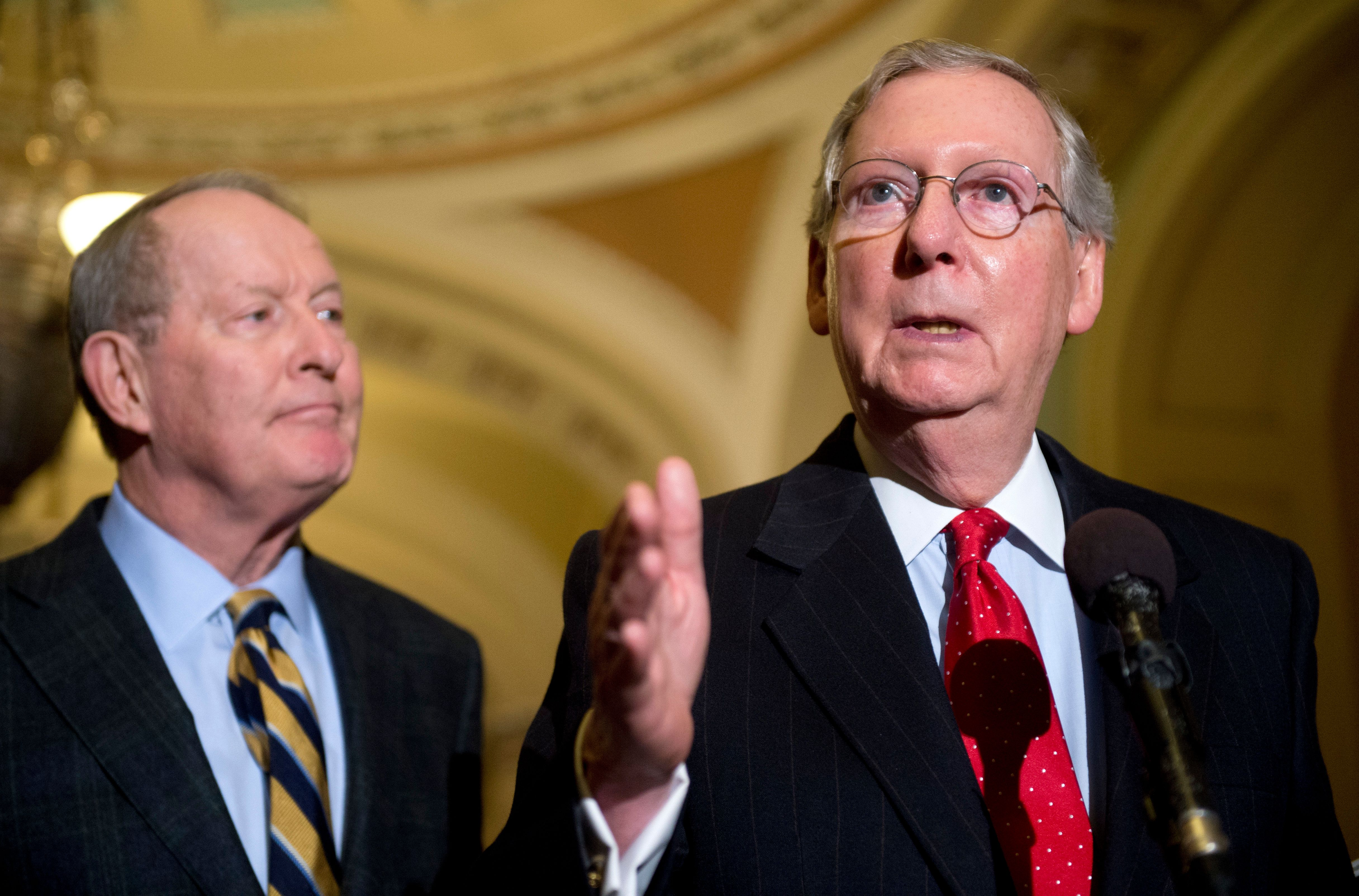 UNITED STATES - NOVEMBER 21: Senate Minority Leader Mitch McConnell, R-Ky., right, and Sen. Lamar Alexander, R-Tenn., conduct a news conference in the Capitol after a vote in the Senate to end the minoritys ability to filibuster and kill most presidential nominations. (Photo By Tom Williams/CQ Roll Call)