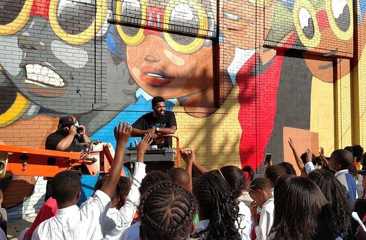 Artist Hebru Brantley speaks to fourth-graders about the mural he painted in Detroit.