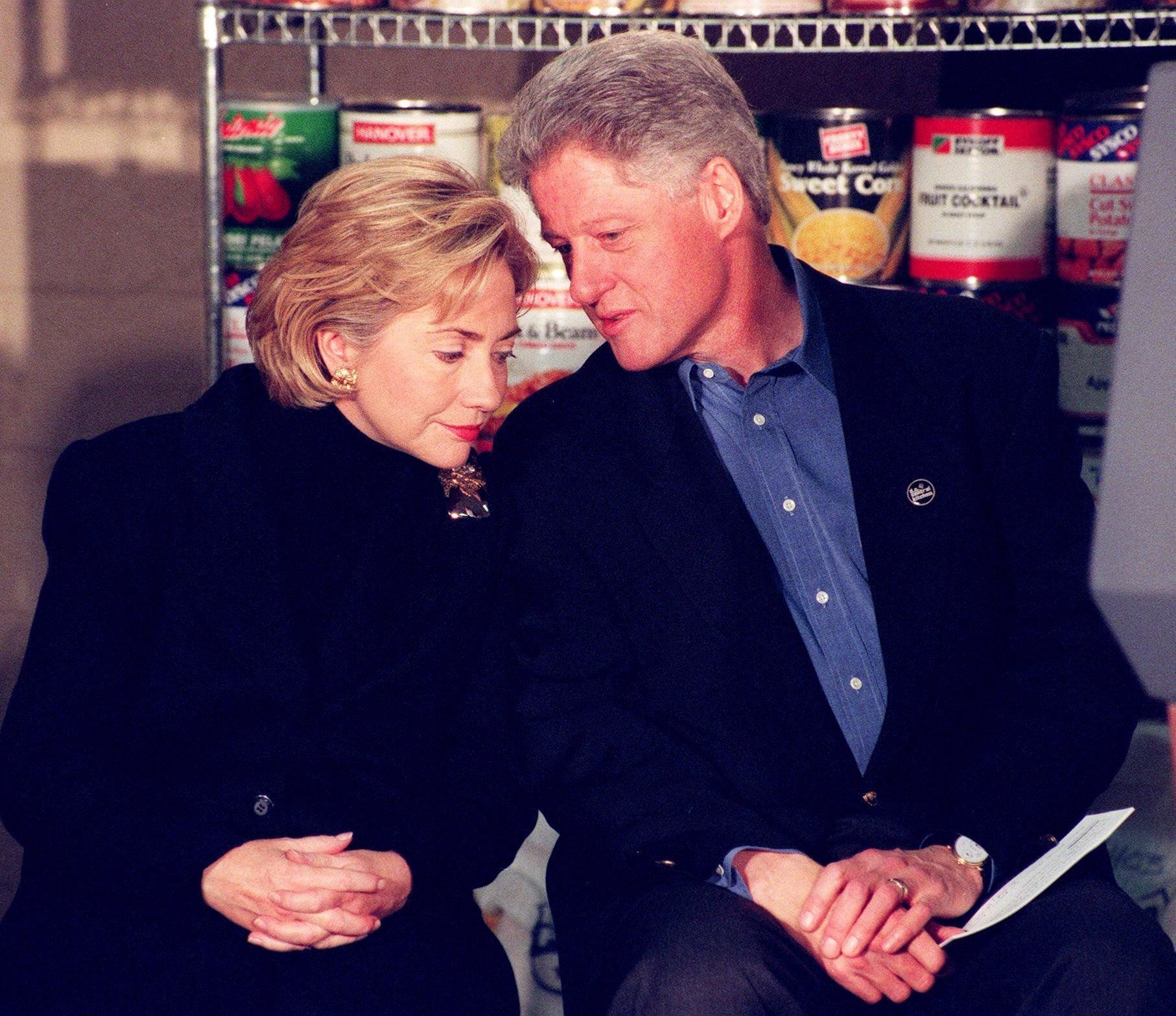 WASHINGTON, :  US President Bill Clinton (R) and First Lady Hillary Clinton (L) prepare to speak to workers at the DC Central Kitchen 21 December before assisting in preparing meals of lasagna that will be used to feed the homeless at emergency shelters in Washington, DC.  The DC Central Kitchen prepares 2,700 meals daily for more than 130 different non-profit organizations.    AFP PHOTO/Joyce NALTCHAYAN (Photo credit should read JOYCE NALTCHAYAN/AFP/Getty Images)