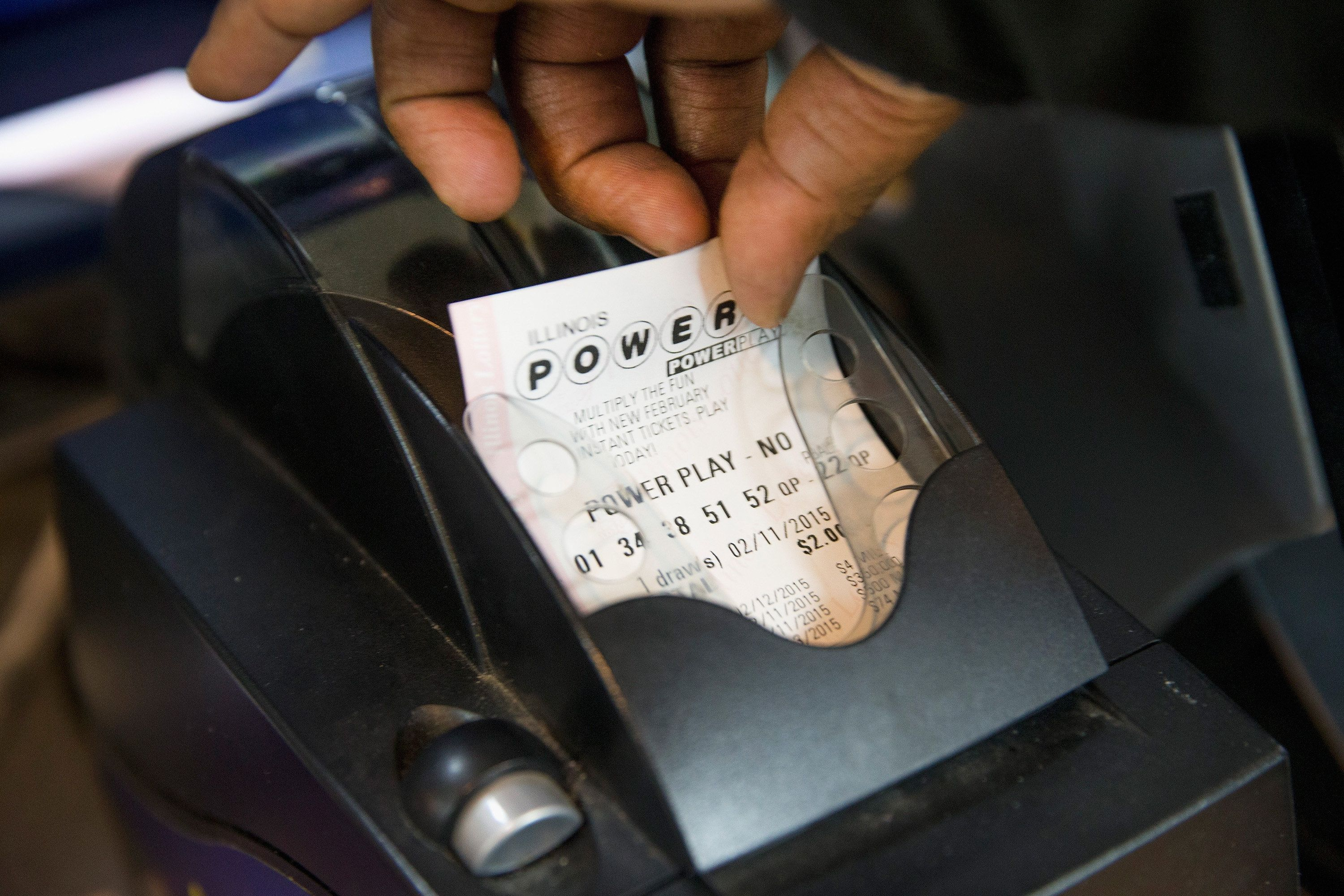 CHICAGO, IL - FEBRUARY 11:  A Powerball lottery ticket is printed for a customer at a 7-Eleven store on February 11, 2015 in Chicago, Illinois. Ticket sales have caused the jackpot to grow $500 million, one of the largest in the game's history.  (Photo by Scott Olson/Getty Images)