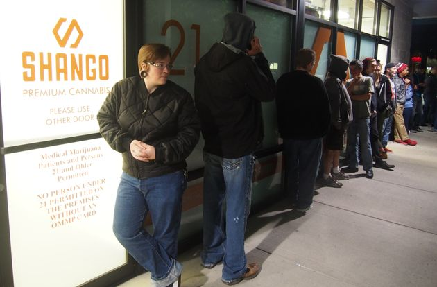 "<span class='image-component__caption' itemprop=""caption"">Davia Fleming waits outside Shango dispensary in Portland, where she'll be one of Oregon's first legal marijuana customers.</span>"