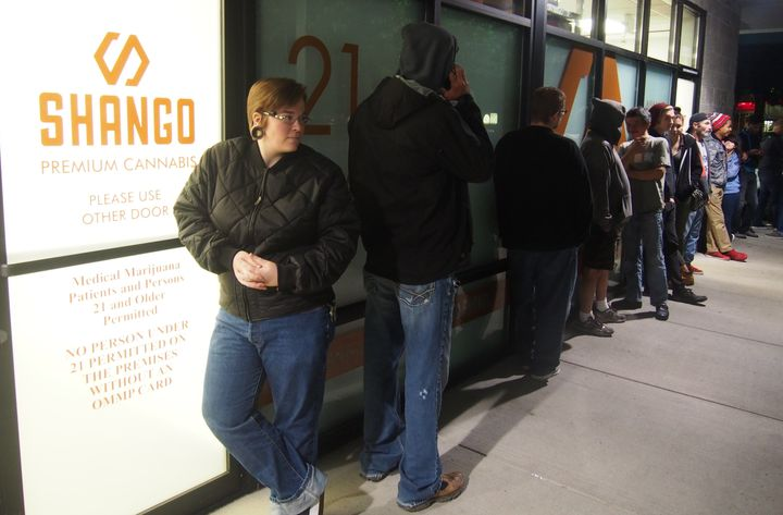 Davia Fleming waits outside Shango dispensary in Portland, where she'll be one of Oregon's first legal marijuana customers.