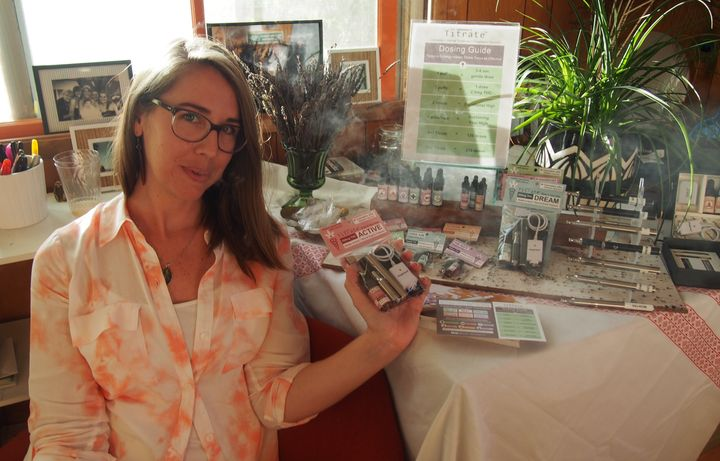 Dyana Patamia of Titrate shows off her company's selection of herbal and THC-infused e-juices at a house party in Portland, c