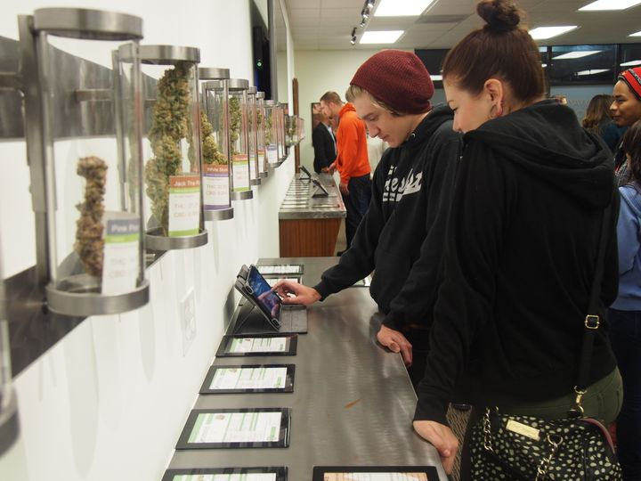 Customers check out strains of marijuana at Shango dispensary in Portland on Oct. 1, 2015.