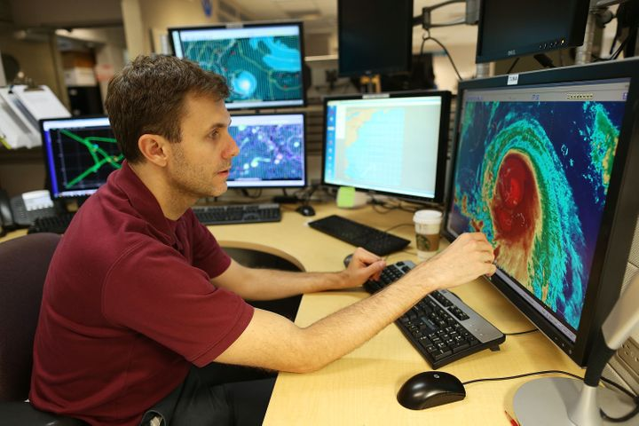 Eric Blake, a hurricane specialist, uses a computer at the National Hurricane Center to track the path of Hurricane Joaquin a