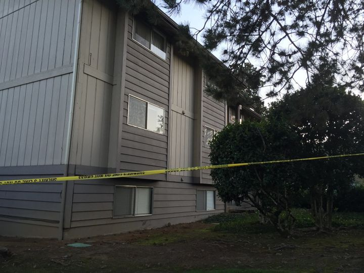 Police taped off an Oregon apartment complex listed as Mercer's address.